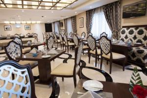 مطعم أو مكان آخر لتناول الطعام في فندق و شقق كورال مسقط