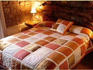 A bed or beds in a room at Posada Molino La Vega
