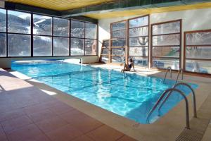 The swimming pool at or near Evenia Monte Alba