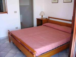 Letto o letti in una camera di Villetta Trilo Janna