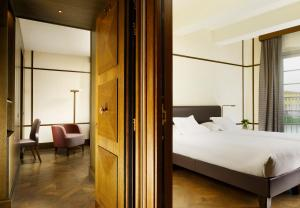 A bed or beds in a room at Hotel Balestri