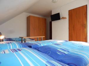 Posteľ alebo postele v izbe v ubytovaní Privat Severka