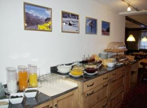 Breakfast options available to guests at Alpenhof Pension-Garni
