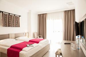 Een bed of bedden in een kamer bij ROBINSON DJERBA BAHIYA - All Inclusive
