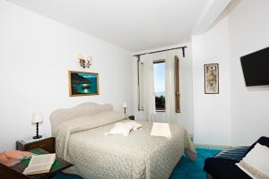 A bed or beds in a room at Casa Antonio