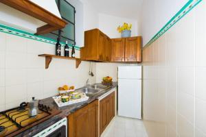 A kitchen or kitchenette at Casa Antonio