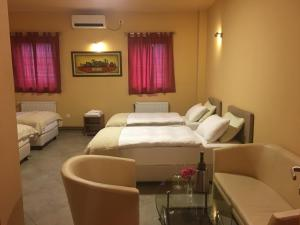 A bed or beds in a room at Hotel Portal