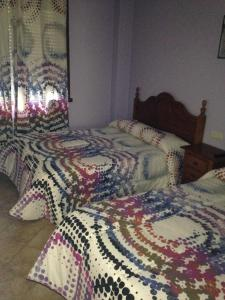 A bed or beds in a room at Pension Meson Paz