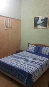 Cama ou camas em um quarto em Pousada Costa da Praia
