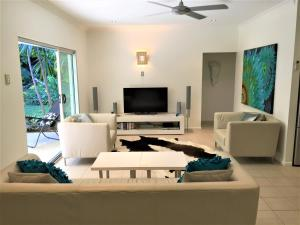 A television and/or entertainment center at Aquatica - Luxe Holiday Home