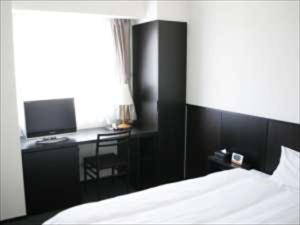 A television and/or entertainment center at Green Rich Hotel Tosu Ekimae