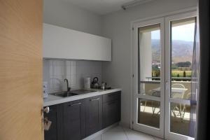A kitchen or kitchenette at Brezza Di Grecale