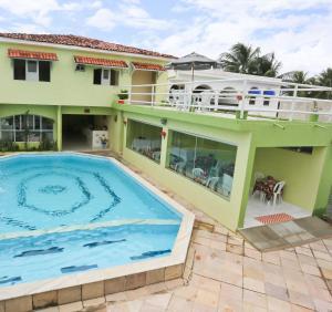 A piscina localizada em Pousada Casa Porto ou nos arredores