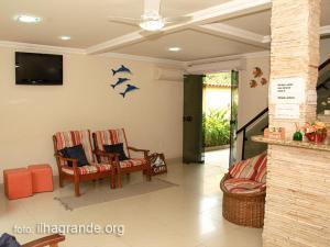 The lobby or reception area at Pousada Juliana