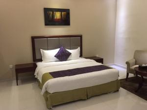 Cama ou camas em um quarto em Taleen Al Nadwa