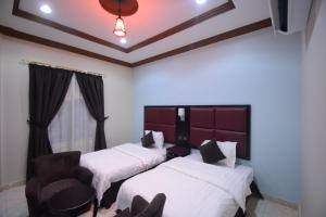 Cama ou camas em um quarto em Rawasi Hotel Suites 3 (For Families Only)