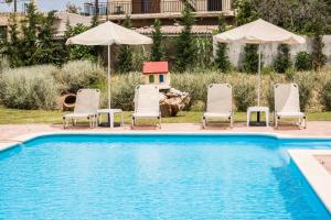 The swimming pool at or near Areti Suites