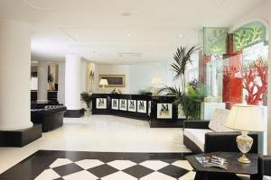The lobby or reception area at M Glamour Hotel