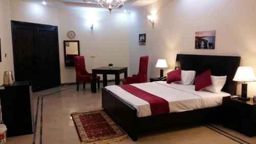 A bed or beds in a room at Serene Residence