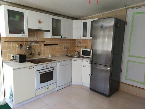 Кухня или мини-кухня в House Krasnodarskaya 3