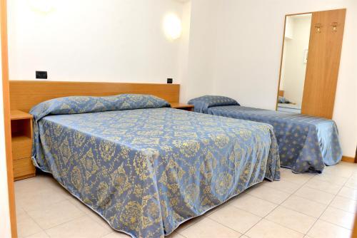 Letto o letti in una camera di Clodi Resort