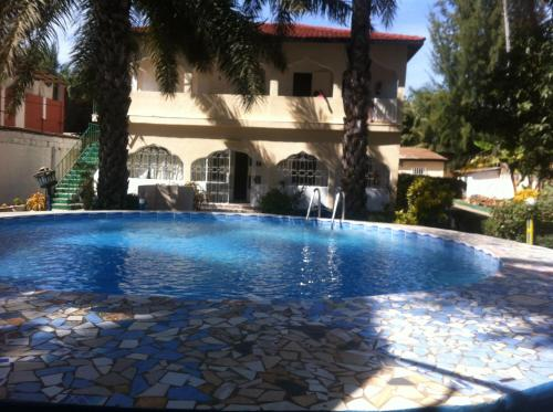 The swimming pool at or near One World Village Guesthouse