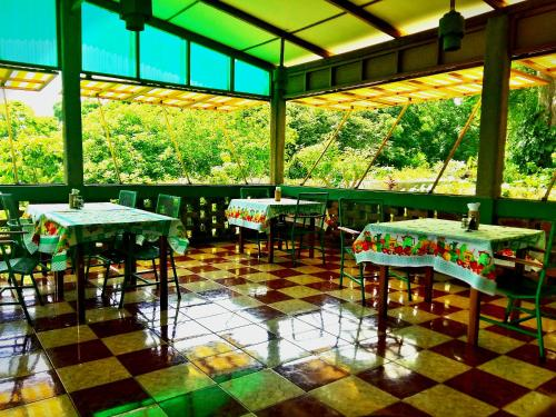 A restaurant or other place to eat at El Encanto Garden Hotel