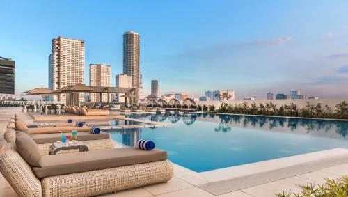 The swimming pool at or near Seda Vertis North Quarantine Hotel