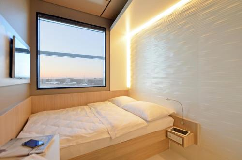 Letto o letti in una camera di MY CLOUD Transit Hotel - Guests with international flight only!
