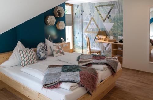 Un ou plusieurs lits dans un hébergement de l'établissement Hostellerie Les Bagenelles