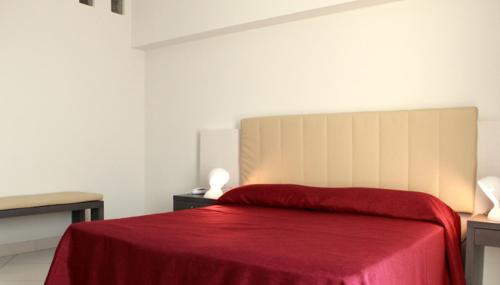 A bed or beds in a room at Brezza Di Grecale