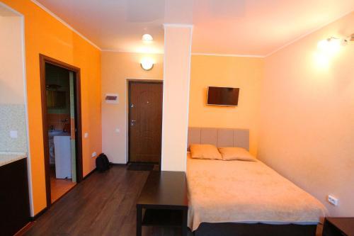 Кровать или кровати в номере Studio on Zvezdnaya