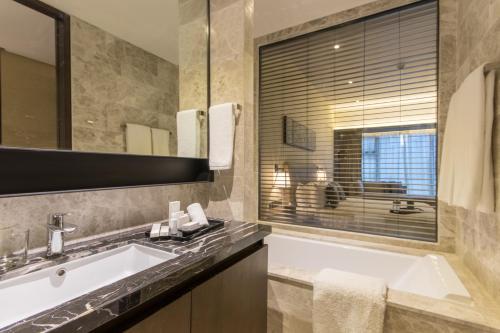 A bathroom at I'M Hotel