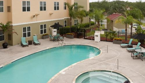 A view of the pool at Residence Inn Orlando Airport or nearby