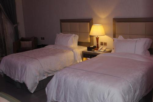 Cama ou camas em um quarto em Refal Homes