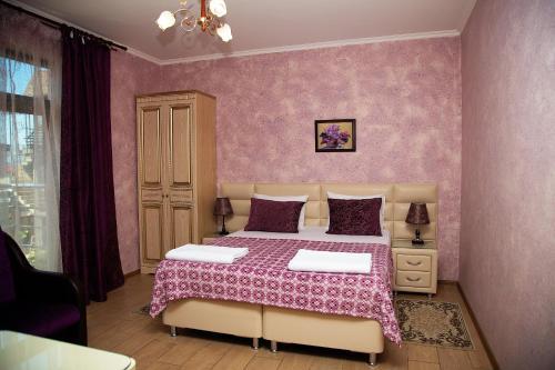 Кровать или кровати в номере Бутик Отель Тамара