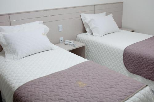 Cama ou camas em um quarto em Hotel Roari