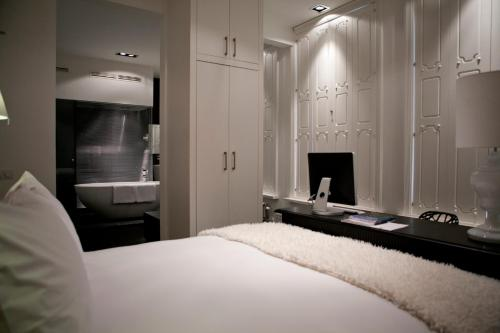 A bed or beds in a room at Manna