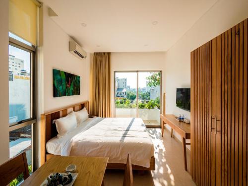 Giường trong phòng chung tại Babylon Garden - a VIE collection
