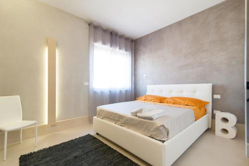 A bed or beds in a room at Bianco Mare