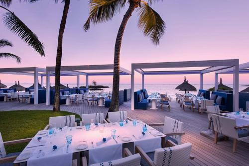A restaurant or other place to eat at Constance Belle Mare Plage