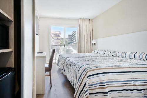 Cama o camas de una habitación en Hotel Best San Diego