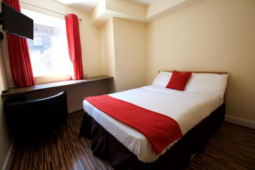 A bed or beds in a room at International Inn