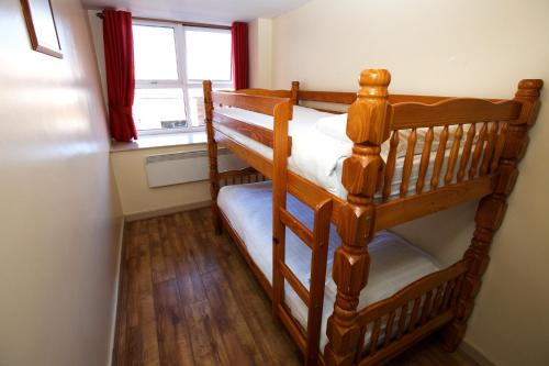A bunk bed or bunk beds in a room at International Inn