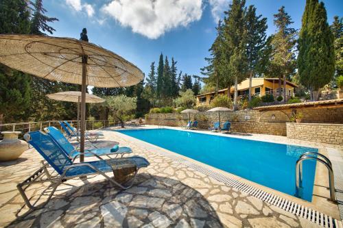 The swimming pool at or near Glyfada Beach Villas