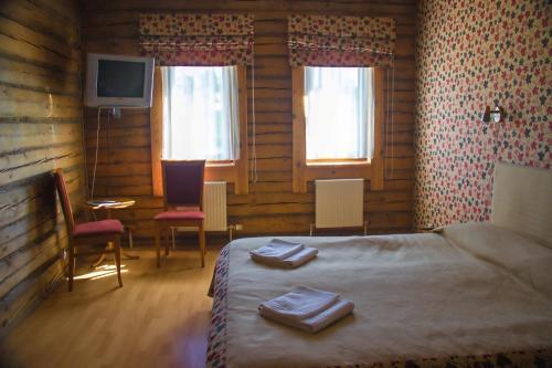Кровать или кровати в номере Отель Стромынка