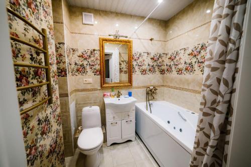 Ванная комната в Комплекс апартаментов «Крылья»