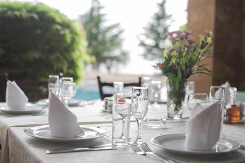 Een restaurant of ander eetgelegenheid bij Hotel Sileks