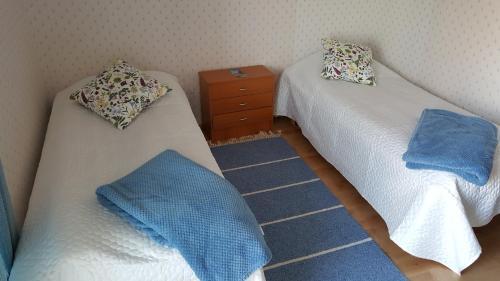Vuode tai vuoteita majoituspaikassa Saaristohotelli Vaihela