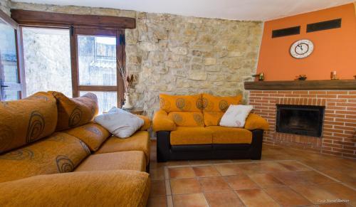 Uma área de estar em Casa Roblan